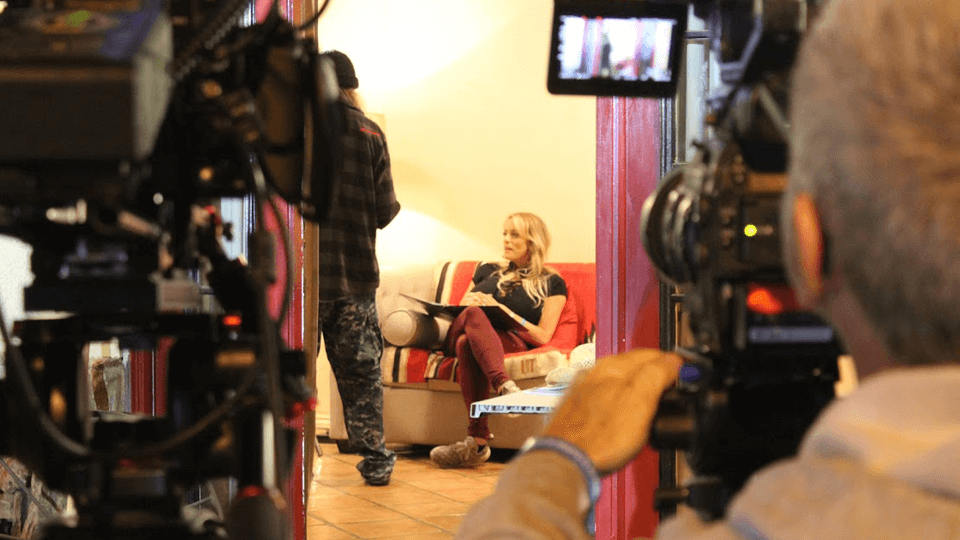"Stormy Daniels commands attention with a bullhorn while directing her first feature for Digital Playground, ""Highway Home."""